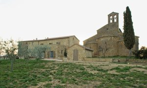 A large parish house attached to an ancient church, the Pieve di Santo Stefano in Cennano, Italy